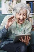 Senior Woman Making Video Call Using Digital Tablet — Stock Photo