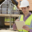 Architect On Building Site Using Digital Tablet — Stock Photo #55059203