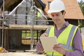 Architect On Building Site Using Digital Tablet — Stock Photo