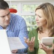 Worried Couple Discussing Domestic Finances At Home — Stock Photo #56229043