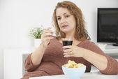 Woman Smoking Cigarette Whilst Drinking Wine And Eating Snacks — Foto de Stock