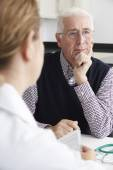 Worried Senior Man Meeting With Doctor In Surgery — Stockfoto