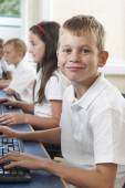 Male Elementary Pupil In Computer Class  — Stock Photo