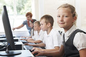 Group Of Elementary Pupils In Computer Class With Teacher — Stock Photo