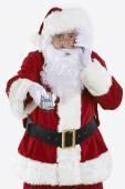 Santa Claus Holding Television Remote Control — Stock Photo
