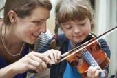 Teacher Helping Young Female Pupil In Violin Lesson — Stock Photo