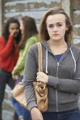 Unhappy Teenage Girl Being Gossiped About By Peers — Stock Photo