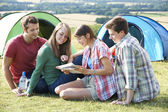 Group Of Young Friends Camping In Countryside Reading Map — Zdjęcie stockowe