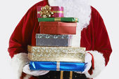Close Up Of Santa Claus Holding Pile Of Gift Wrapped Presents — Stock Photo
