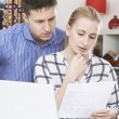 Worried Couple Discussing Domestic Finances At Home — Stock Photo #60831133