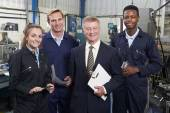 Portrait Of Manager And Staff In Engineering Factory — Stock Photo