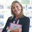 Portrait Of Female Estate Agent In Office — Stock Photo #62683797