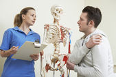 Male Patient Describing Injury To Osteopath — Stock Photo