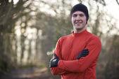 Portrait Of Man On Winter Run Through Woodland — Stock Photo