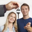 Dealer Handing Over Keys For New Car To Young Couple — Stok fotoğraf #66395743