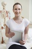 Portrait Of Female Osteopath In Consulting Room With Digital Tab — Stockfoto