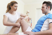 Osteopath Treating Male Patient With Sports Injury — Stock Photo