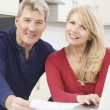 Smiling Mature Couple Reviewing Domestic Finances — Stock Photo #67082673