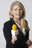 Female Journalist With Microphone On White Background — Stock Photo