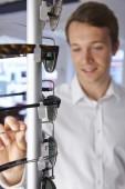 Man Choosing Glasses In Opticians — Stock Photo