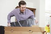 Man Unpacking New Television At Home — Stock Photo