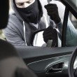 Masked Man Breaking Into Car With Crowbar — Stock Photo #68313879