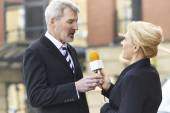 Female Journalist With Microphone Interviewing Businessman  — Stock Photo