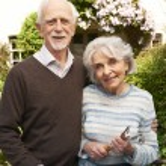 Senior Couple Working In Cottage Garden — Stock Photo #70406473