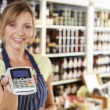 Sales Assistant In Food Store Handing Credit Card Machine To Cus — Stock Photo #70408839