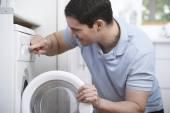 Engineer Mending Domestic Washing Machine — Stock Photo