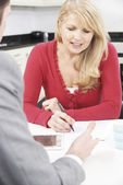 Mature Woman With Financial Advisor Signing Document At Home — Stockfoto
