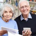 Portrait Of Smiling Senior Couple Reviewing Home Finances — Stock Photo #71335999