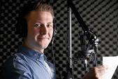 Man In Recording Studio Talking Into Microphone — Stock Photo