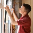 Construction Worker Installing New Windows In House — Stock Photo #71341353