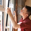 Construction Worker Installing New Windows In House — Stock Photo #71341565