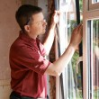 Construction Worker Installing New Windows In House — Stock Photo #71342253