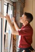Construction Worker Installing New Windows In House — Stock Photo
