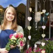 Florist Standing Outside Shop With Bunch Of Flowers — Stock fotografie #72652303