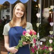 Florist Standing Outside Florist Shop With Bouquet — Стоковое фото #72652439