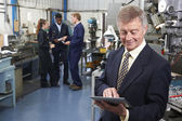 Owner Of Engineering Factory Using Digital Tablet With Staff In — Stock Photo