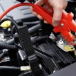 Close-Up Of Mechanic Attaching Jumper Cables To Car Battery — Stock Photo #73454119
