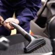 Man Hoovering Seat Of Car During Car Cleaning — Stock Photo #73454689