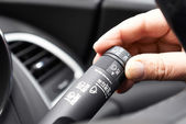 Close Up Of Hand Operating Windscreen Wiper Control In Car — Stock Photo