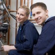 Female Trainee Plumber Working On Central Heating Boiler — Stock Photo #75335367