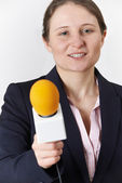 Studio Portrait Of Female Journalist With Microphone — Stock Photo