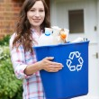 Portrait Of Woman Carrying Recycling Bin — Stock Photo #76067913