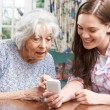 Teenage Granddaughter Showing Grandmother How To Use Mobile Phon — Stock Photo #76069755