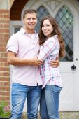 Portrait Of Loving Couple Standing Outside Home — Stock Photo