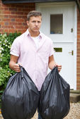 Portrait Of Man Taking Out Garbage In Bags — Stock Photo