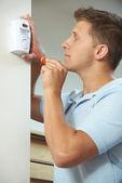 Security Consultant Fitting Burglar Alarm Sensor In Room — Stock Photo